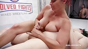Bella Rossi mixed sex wrestling gives a hand-job then Strapon Fucks the fool