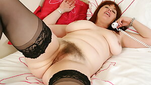 British mum Janey fucks her fur covered pussy with a dildo