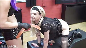 Domme likes to train her sissy slave with belt cock