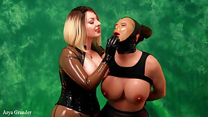 Mistress in latex playing with rubber sissy sex doll